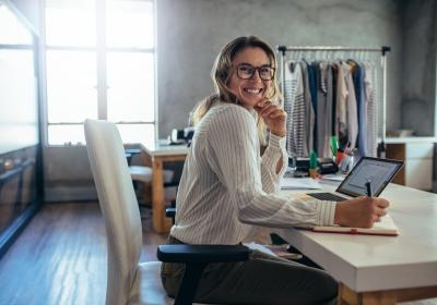 Online seller businesswoman at office